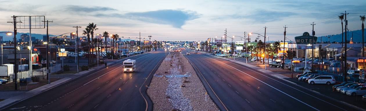 In the shadow of the Strip, the jumbled stretch of road tells another Vegas story.