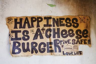 """Happiness is a cheese burger. Drive safe. Love life."""