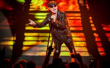 Singer Klaus Meine doesn't just hit the high notes, he knocks 'em over the fence into the bleacher seats.
