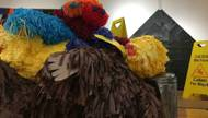 "Among the highlights is Favela's ""Untitled (Muppet Pile),"" featuring eight Jim Henson creations, from Slimey to Snuffleupagus, in a belly-up heap. Rendered life-size in piñata medium, their perky colors and adorable faces seem at odds with their compromised positions."