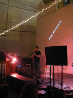Doug Benson performs in the backyard at Beauty Bar for 125 eager listeners
