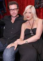 Tori Spelling places a restful hand on Dean McDermott.