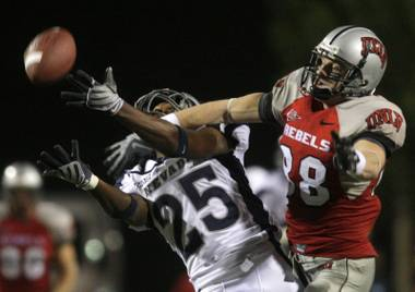 UNR's Mo Harvey, left, and UNLV's Ryan Wolfe, right.