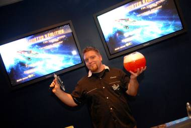 Darren Benjamen holds up a phaser and a drink during the Downstairs Bar's Star Trek-themed party.