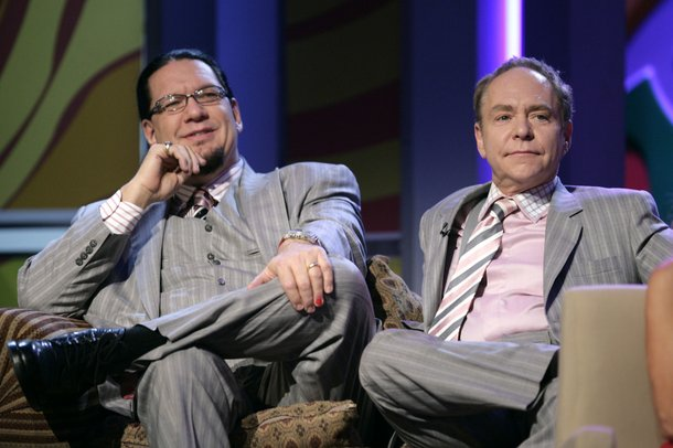 Penn & Teller, the night's other celebrated comedy team, wait their turn onstage.