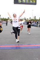 702.tv host (and my roommate) Denise Spidle leaps across the finish line of the Vegas marathon, her first, on December 7.