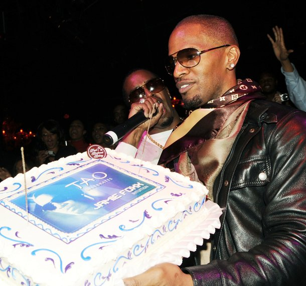 Jamie Foxx receives his second birthday cake of the night at Tao. On the mic is good friend P.Diddy.