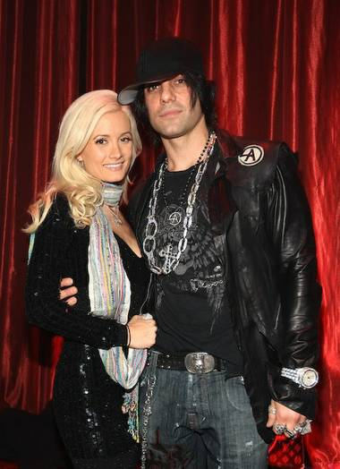 Lovebirds Criss Angel and Holly Madison flew off this morning to start a weeklong vacation at a luxury beachfront resort in the millionaire's playground of Cabo San Lucas.