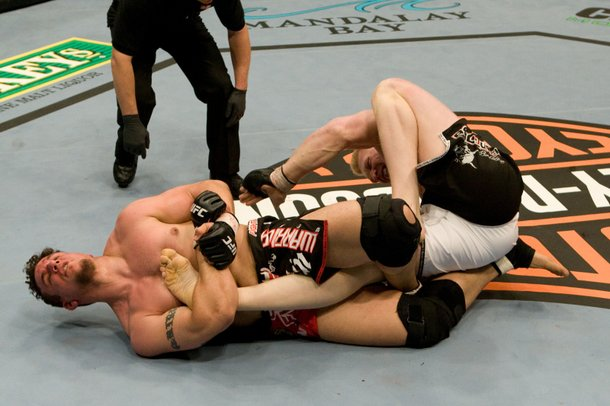 Frank Mir does some ground work on Brock Lesnar.