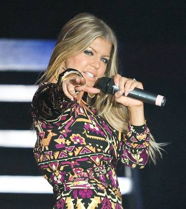 Here's a fabulous photo gallery, by our fabulous contributing photographer Erik Kabik, of Fergie in concert on New Year's Eve at The Venetian Ballroom, where she heated up the stage before counting down to 2009 next door at Lavo in the Palazzo.