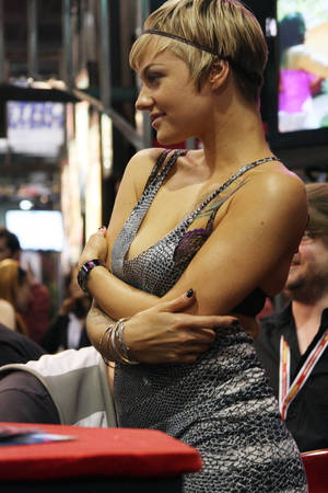 Belladonna poses during a signing at AEE.