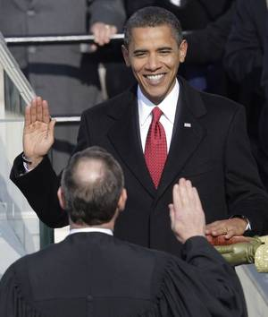 Barack Obama takes the oath of office from Chief Justice John Roberts to become the 44th president of the United States at the U.S. Capitol in Washington.