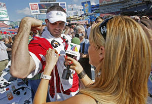 Arizona Cardinals Matt Leinart has his bicep measured by Ines Sainz of TV Azteca during Super Bowl XLIII media day at Raymond James Stadium.