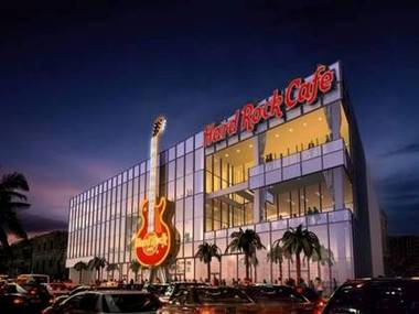 This artist rendering of the new Hard Rock Cafe - Las Vegas Strip shows the 60-foot guitar that will also house the building's elevator. It does not show the giant Coca Cola bottle that will be its neighbor.
