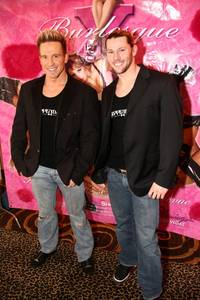 "Chippendales dancers James Wilcox and Jace Crispin walk the red carpet at the second anniversary of the Flamingo's ""X Burlesque."""