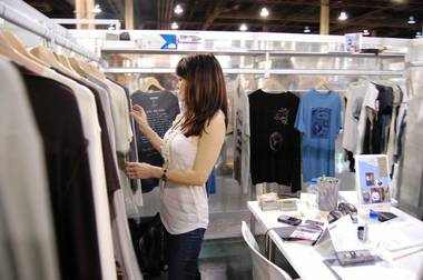 Substance founder Patricia Zeto looks through shirts at her company's booth at PROJECT this past week. Zeto and partner Linda Werner started their hemp clothing line in August 2008 to inform consumers of the environmental benefits of the U.S.-banned plant.