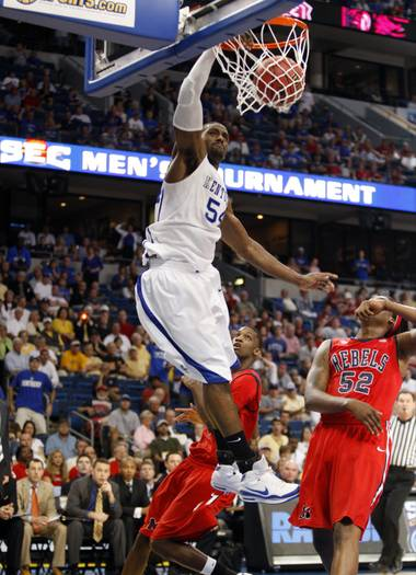 Kentucky's Patrick Patterson dunks past Mississippi defenders, including Deaundre Cranston (52) during the first half of an NCAA college basketball game at the Southeastern Conference men's tournament Thursday, March 12, 2009, in Tampa, Fla.