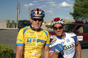 Ryan Pretner is shown with Lance Armstrong during a fundraising ride. Ryan, 37, suffered a fractured skull and was in a coma for more than 60 days after he was struck on the back of the head by a truck's side mirror Jan. 12, while he was cycling on St. Rose Parkway