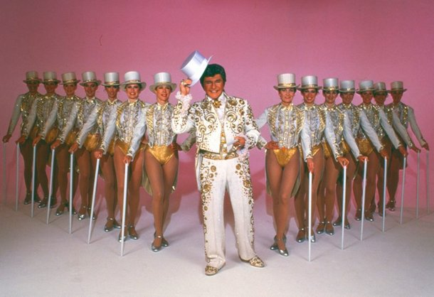 Liberace with the Rockettes.