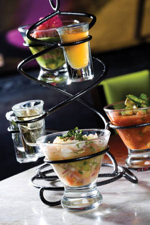 T&T's incarnation of a combo platter, various ceviches paired with a flight of tequilas.