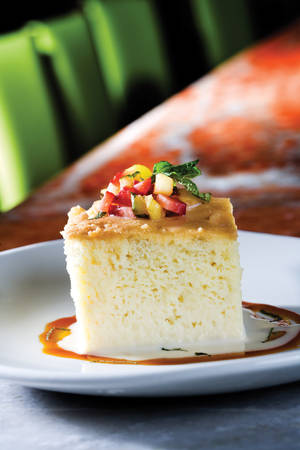 Tres leches cake, a sweet and moist dessert made with three kinds of milk.