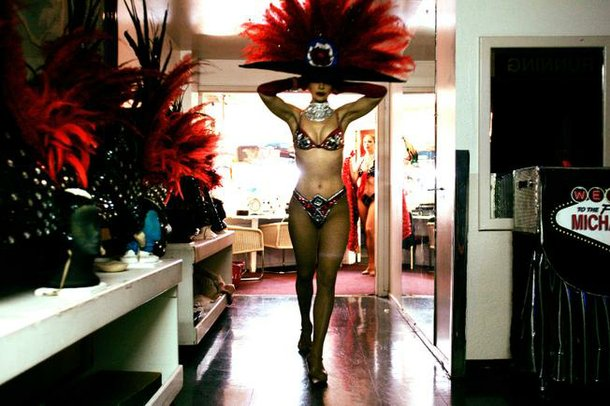 Showgirl Svetlana Failla secures her headdress before going onstage for the opening number of Folies Bergere.