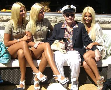The Shannon Twins, Hugh Hefner and Crystal Harris at the Palms Place pool.