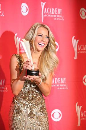 Julianne Hough holds her ACM Award for Top New Artist at the 2009 Academy of Country Music Awards at MGM Grand Garden Arena.