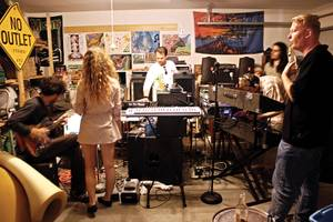 Nomads at work: Caparso (far left) and members of the Acid Cavalry jam out.