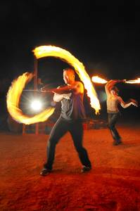 Tam's methods of conquering fear includes fire spinning.
