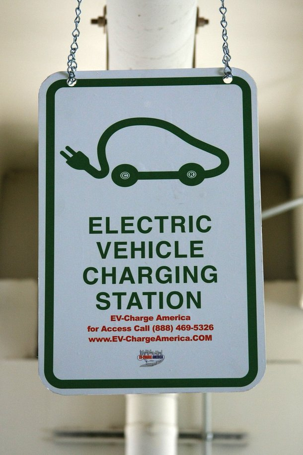 An electric-car charging station sign at Rampart Casino.