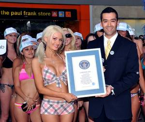 Holly Madison, Guinness Book of World Records executive Danny Girton and the world record proclamation.
