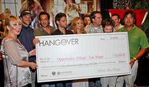 <em>The Hangover</em> cast with their check to Opportunity Village.