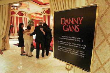 People head toward the Encore Theatre for a memorial for Danny Gans last Thursday.