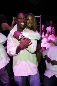 Singer Toni Braxton hugs Tyrese Gibson during a night out at the Bank.