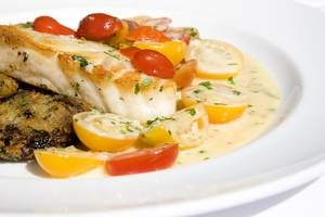 Roasted Chilean sea bass with heirloom tomatoes.