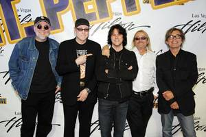 Iron Chef Kerry Simon is flanked by Cheap Trick, who will be performing at the Las Vegas Hilton in September.