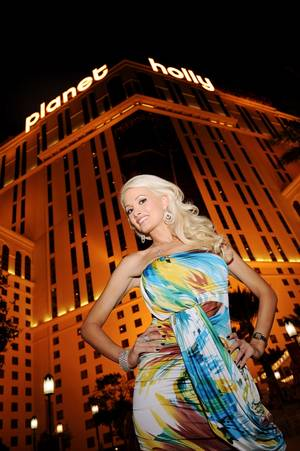 "Holly Madison stands in front of the newly transformed ""Planet Holly."""