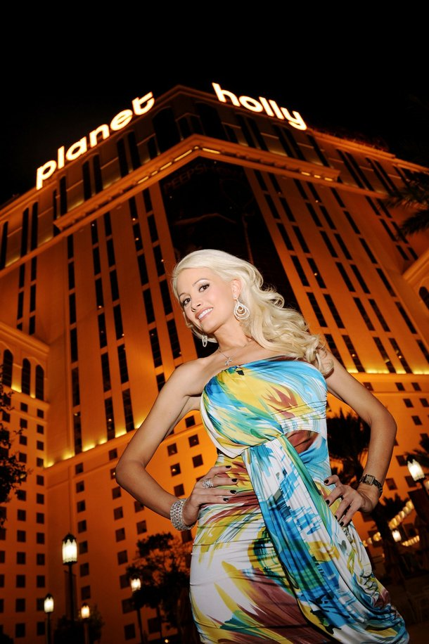 Holly Madison stands in front of the newly transformed