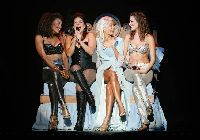 The bed scene in <em>Peepshow</em> at Planet Hollywood. Shoshana Bean is second from left, and Holly Madison is second from right.