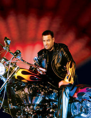 A leather-clad Steve Wyrick atop a motorcycle.
