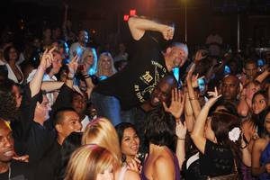 Former UFC champion Chuck Liddell is hoisted above the crowd during a performance by rapper Nelly at Jet.