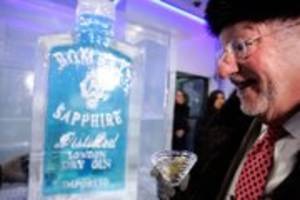Mayor Oscar Goodman excitedly watches as a shot of Bombay Sapphire gin is prepared for him in a shot glass made of ice at the Minus 5 Experience at Mandalay Place on June 23.