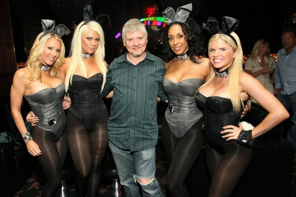 Dave Foley is flanked by Playboy Bunnies at the Palms.