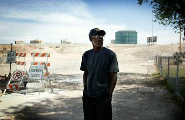 Saul Willis stands on the portion of F Street near his home at McWilliams Avenue that was closed in September to make way for the Interstate 15 widening project.