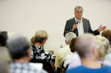 County Commissioner Steve Sisolak moderates during a Searchlight Town Hall Meeting about a proposed wind energy project at the Searchlight Community Center Thursday, June 25, 2009.