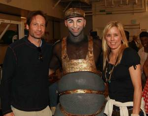 David Duchovny and Tea Leoni flank <em>Love</em> cast member Valeriy Kharun.