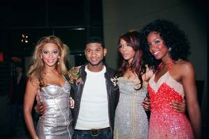 Usher is flanked by Destiny's Child.
