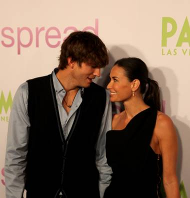 Ashton Kutcher and wife Demi Moore pose for pictures on the red carpet at the Palms' Brenden Theatres during the Las Vegas premiere his new movie Spread.