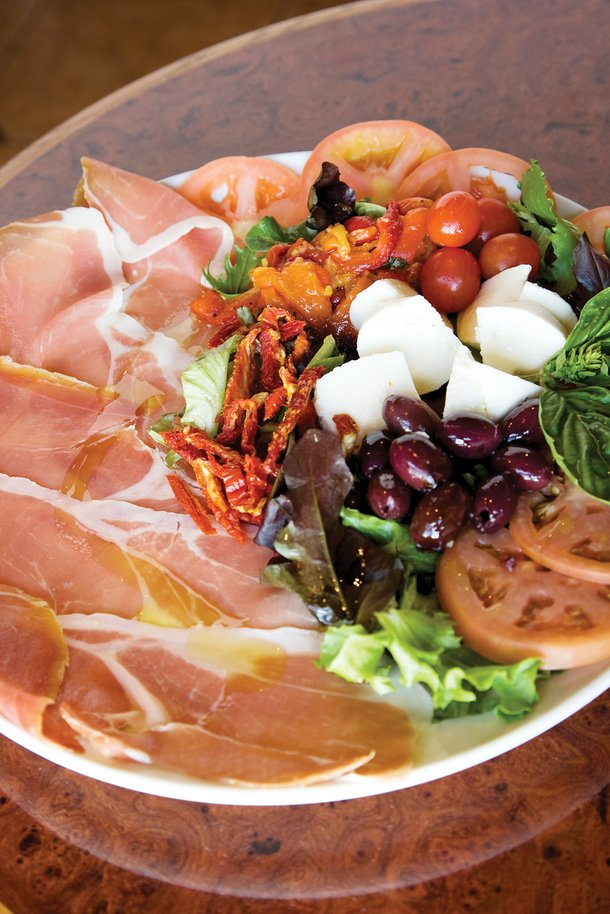 Caffe Dolce's thinly sliced San Daniele prosciutto is accompanied by burrata cheese, creamy mozzarella hearts, roasted peppers and brine-cured olives.